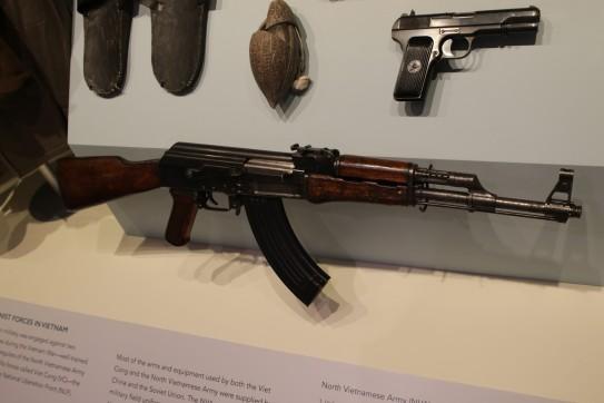 "North Vietnamese Army Kalashnakov (AK47/AKM) Rifle (LEW-00222), Vietnamese Tokarev (Type 51) Pistol (LEW-05916), North Vietnamese Army ""Ho Chi Minh"" Sandals (LEW-05492), Handmade Coconut Shell Soap Dish (LEW-09089)"